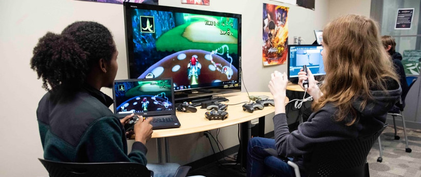 two students testing a video game