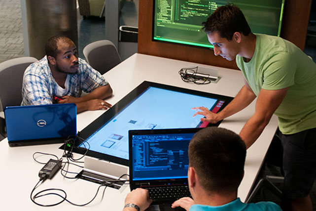Cyber Security students at learning commons on the Armstrong campus
