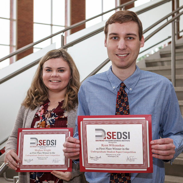 IT students Meghan Wright and Ryan Wilcauskas  holding 1st place awards for their paper at the SEDSI conference.